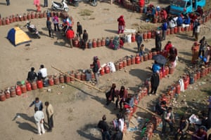People queue to refill gas cylinders in Kathmandu.