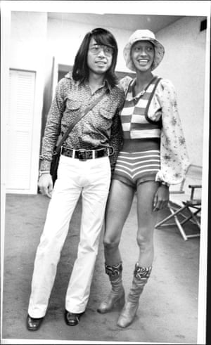 Kenzo Takada, left, and Carol LaBrie – Takada's muse and the first Black model to appear on the cover of Italian Vogue – in New York, 1971. La Brie is wearing Kenzo's trademark stripes, checks and flowers