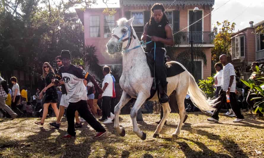A street parade in New Orleans in 2012 from Peter van Agtmael's 'unsettling' Buzzing at the Sill