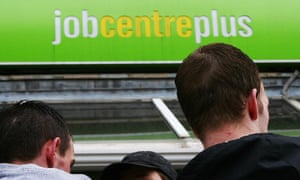 Three people stand outside a Jobcentre.