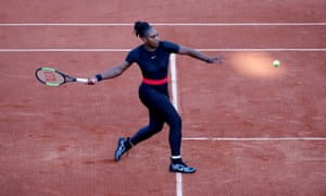 Serena Williams gets ready to fire a forehand return back to Ashleigh Barty.