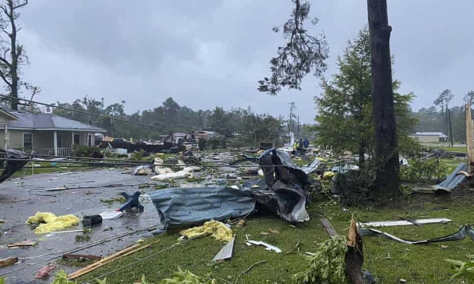 Debris covering the street in East Brewton, Alabama, on Saturday from tropical storm Claudette.