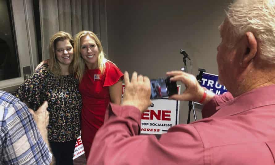 Greene, in the red, is one of the better known congressional candidates who follows the baseless QAnon movement.