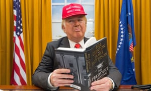 A Donald Trump look-a-like reads The President Is Missing, an upcoming thriller by Bill Clinton and James Patterson at London book fair on Tuesday.