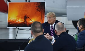 Trump at his briefing in Sacramento on Monday. As one official described how climate change was worsening wildfires, Trump interrupted to say: 'It will start getting cooler.'