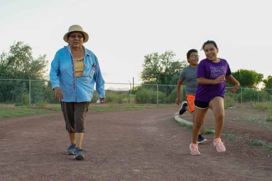 Gloria Hosteen gets some exercise with grandson Logan and granddaughter Destenie, at the track of the former Shiprock High School.