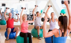 A fitness instructor takes a class