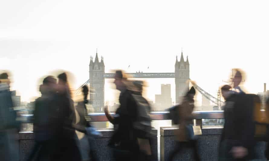 Motion blur shot of commuters walking to work across London Bridge