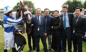 Vichai Srivaddhanaprabha with Glorious Goodwood winner Beat The Bank in 2017, and Bangkok's trainer, Andrew Balding, second right.
