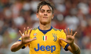 Paulo Dybala celebrates completing his hat-trick by scoring Juventus's fourth goal in the victory against Genoa
