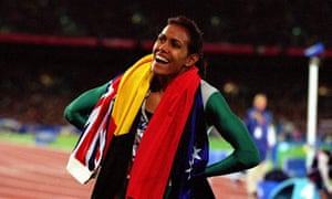 Cathy Freeman celebrates after winning gold in the Women's 400m final at the Sydney 2000 Olympics.