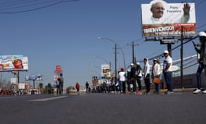 People line a street ahead of Pope Francis' upcoming visit during a rehearsal in Juárez. The Pope is expected to focus on poverty and social justice.