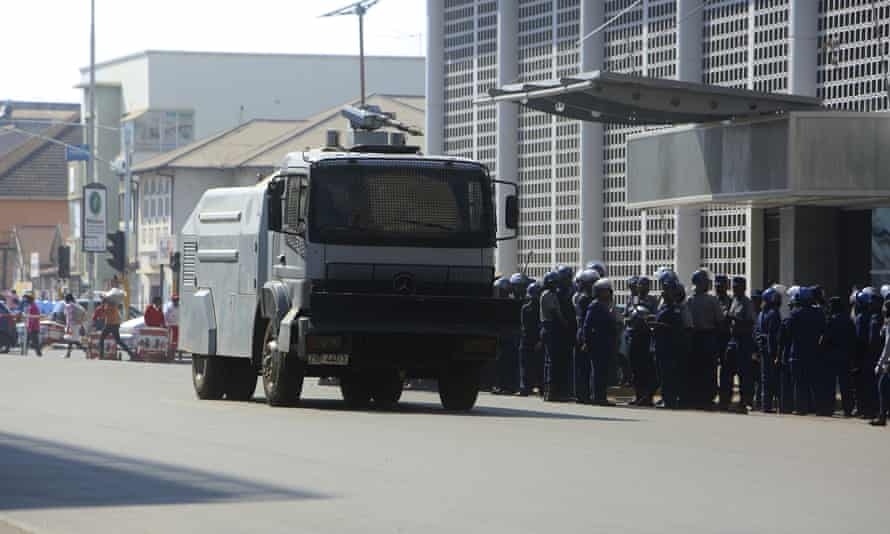 Riot police and water cannon on the streets of Harare