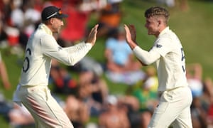 Sam Curran celebrates a South African wicket with captain Joe Root.