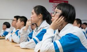 Children listen to Teacher Wang at a workshop about saving water.