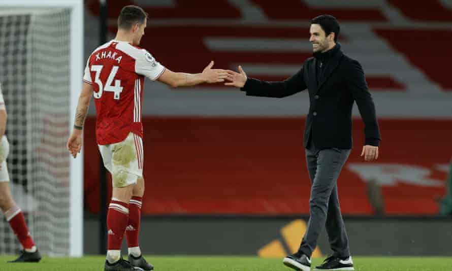 Mikel Arteta shakes hands with Granit Xhaka after Arsenal's 3-1 win over Chelsea on Boxing Day.