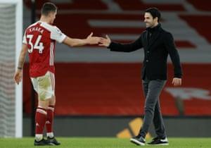 Arsenal manager Mikel Arteta (right) celebrates their win with goalscorer Granit Xhaka.