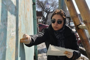 Shamsia Hassani works on a mural in Serahi Alauddin, Kabul.