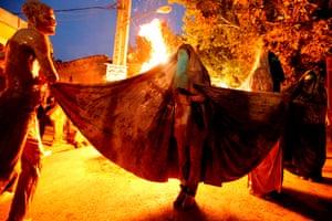 Woman next to bonfire
