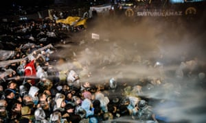 Turkish anti-riot police launch water cannon and teargas to disperse supporters of the Zaman newspaper in Istanbul.