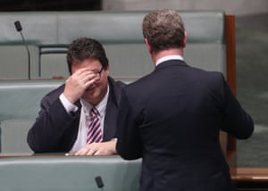 The leader of the house Christopher Pyne talks to the member for Dawson George Christensen.
