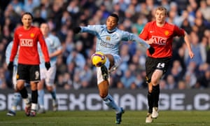Robinho gets on the ball in the first Manchester derby following Adug's takeover of the club in 2008.