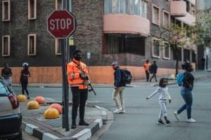 Armed guard at street corner