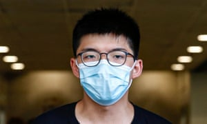 Joshua Wong arrives at court on 6 July after being charged on suspicion for organising illegal protests in Hong Kong.