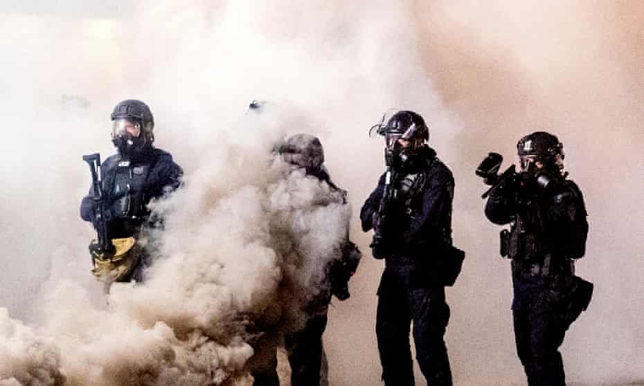 Federal officers use chemical irritants and projectiles to disperse Black Lives Matter protesters on 24 July 2020, in Portland.