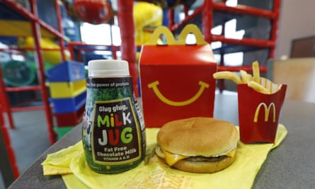 McDonald's says diners can still ask for cheeseburgers and chocolate milk, but not listing them will reduce how often they're ordered.