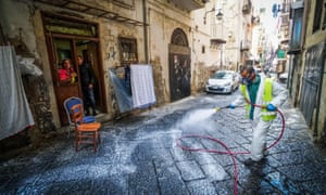 A worker disinfects the streets in Naples, Italy.