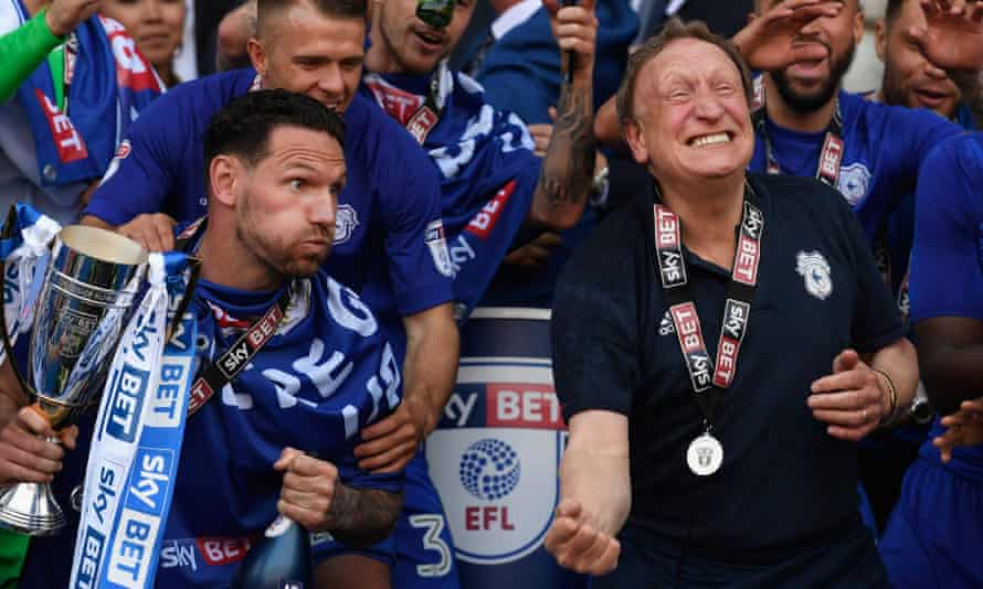 Neil Warnock celebrates promotion in May. The purse-strings have since been loosened, but the manager prefers not to buy big names.