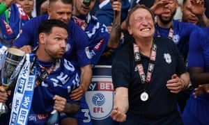 Neil Warnock celebrates promotion to the Premier League with the Cardiff captain, Sean Morrison, who was discarded by Reading four years ago.