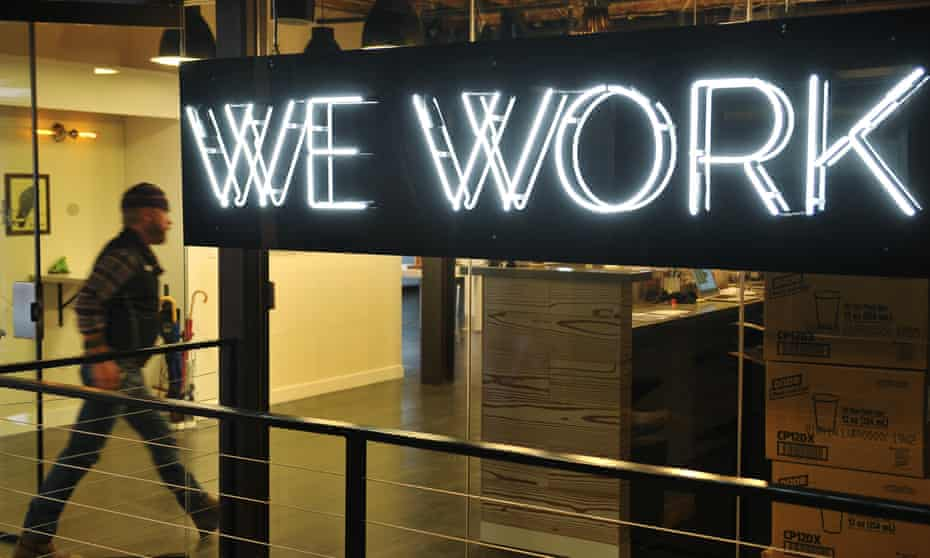 A man entering the WeWork co-operative co-working space in Washington, DC
