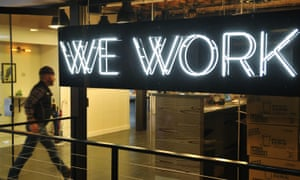 A man enters WeWork's co-working space in Washington, US.