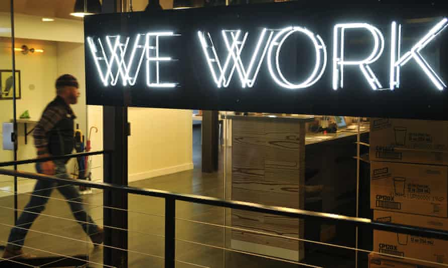 A man entering the doors of the WeWork co-operative co-working space in Washington