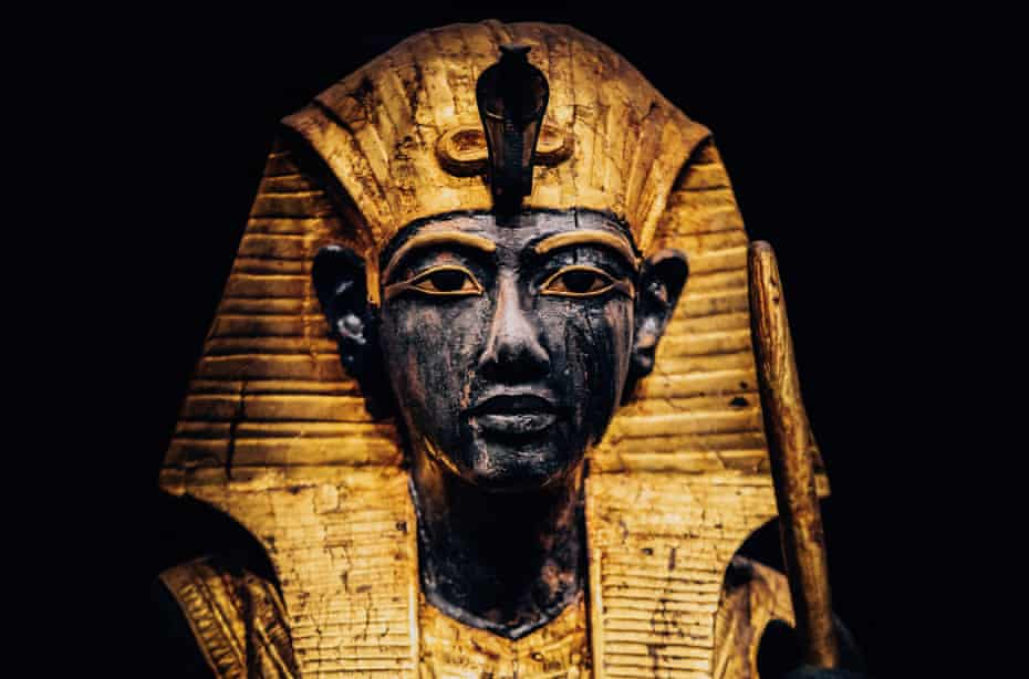 part of a wooden guardian statue of the ka of the king, wearing the Nemes headcloth, from Tutankhamun: Treasures of the Golden Pharaoh.