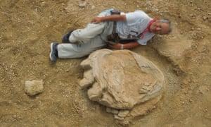 Okayama University of Science professor Shinobu Ishigaki lies next to the footprint in the Gobi desert.