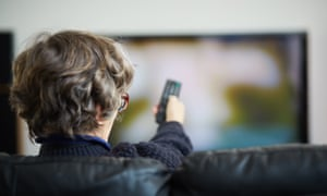 Woman points remote at TV