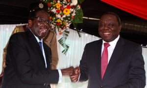 Robert Mugabe as president and Morgan Tsvangirai as prime minister after signing Zimbabwe's new constitution into law in 2013.