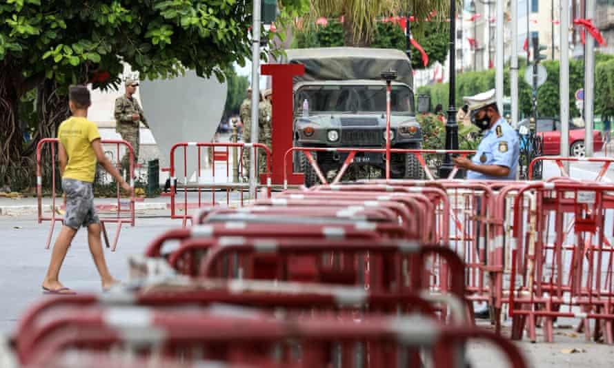 The Tunisian army monitors activity on Habib Bourguiba, one of the main streets of the capital Tunis