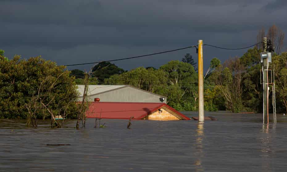 Submerged buildings rise from flood waters at Pitt Town Bottoms, on Sydney's outskirts.