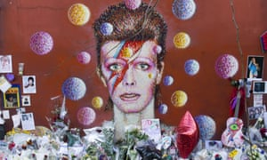 Floral tributes at the David Bowie mural in Brixton, south London.
