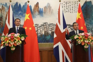 Jeremy Hunt and Chinese state councilor and foreign minister Wang Yi in Beijing, July.