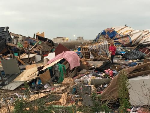 Dehumanising … a child wanders through the rubbish-strewn Jungle camp.