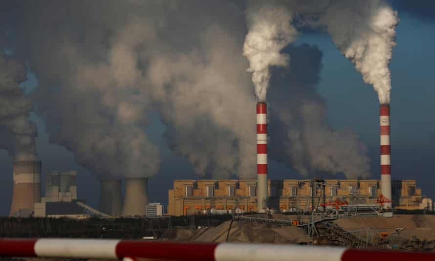Smoke and steam billows from Belchatow power station, Europe's largest coal-fired power plant
