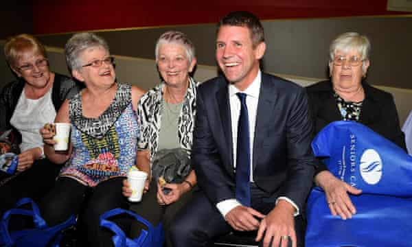 NSW Premier Mike Baird meets with attendees at a NSW Seniors Week Premier's Gala Concert, in Sydney, Tuesday, March 17, 2015. Mr Baird has pledged to commit $2 million to help the state's 1.3 million seniors card holders leverage better deals with the private sector. (AAP Image/Dan Himbrechts) NO ARCHIVING