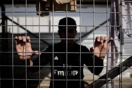 A man who escaped from Mosul inside a Kurdish security screening area at the Dibaga camp.