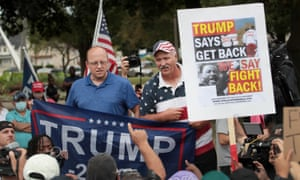 Trump supporters and protesters gather near the Kenosha county court while Donald Trump visits the city on 1 September.