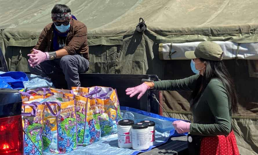 Volunteers load supplies into a pickup truck at a farm, used as a base for aid to Navajo families quarantined in their homes due to coronavirus in Hogback, Shiprock, New Mexico, last month.
